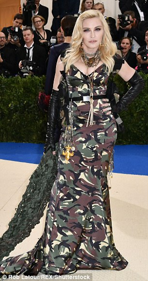 3FD3FEDB00000578-4464478-Fashion_war_Madonna_arrives_to_the_Met_Gala_on_Monday_wearing_a_-a-20_1493710643157